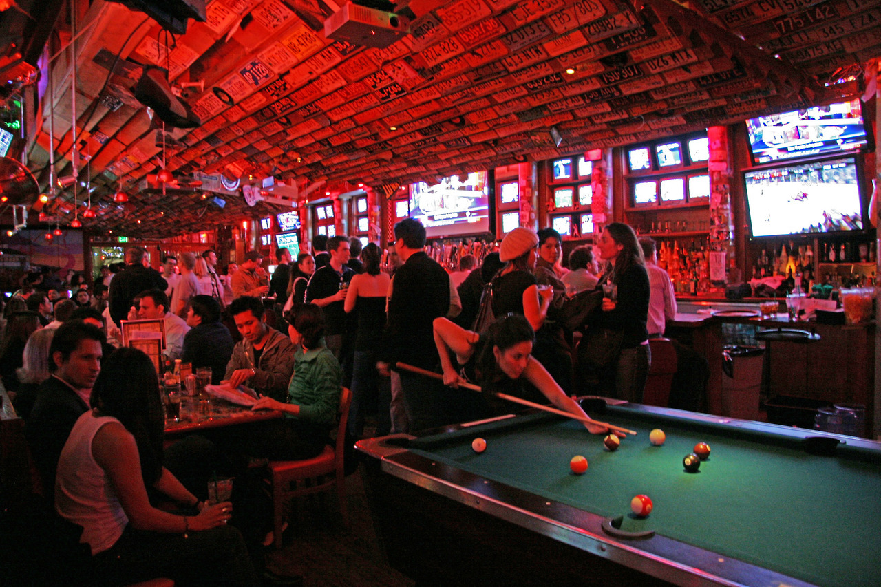 Barney's Beanery bar interior pool tables with customers playing, eating and drinking