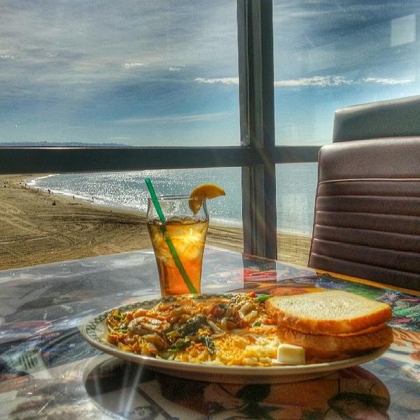 Breakfast plate at table overlooking beach