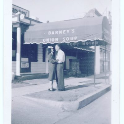 Couple kissing under Barney's awning
