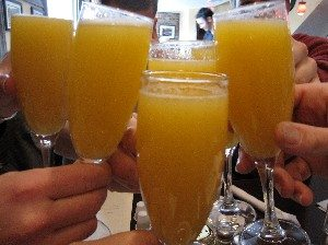 people toasting mimosas