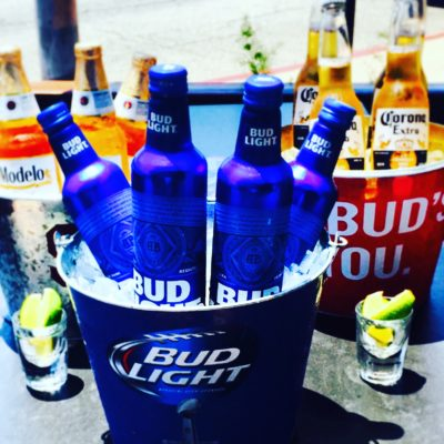 Buckets of bottled beer on patio
